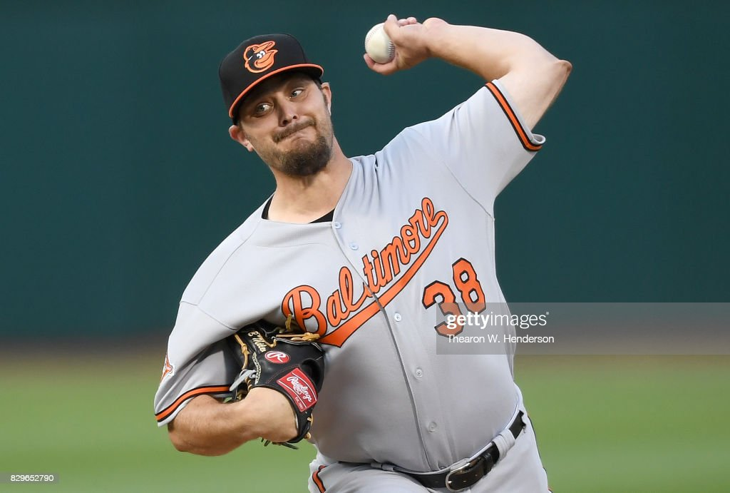 Wade Miley #38 of the Baltimore Orioles pitches against the Oakland Athletics in the bottom of the first inning at Oakland Alameda Coliseum on August 10, 2017 in Oakland, California.