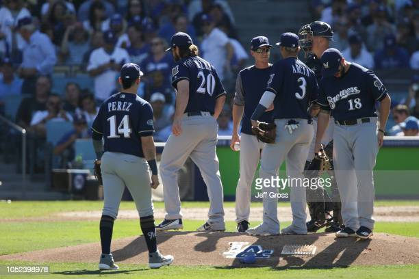 Wade Miley of the Milwaukee Brewers is taken out of the game during the first inning against the Los Angeles Dodgers in Game Five of the National...