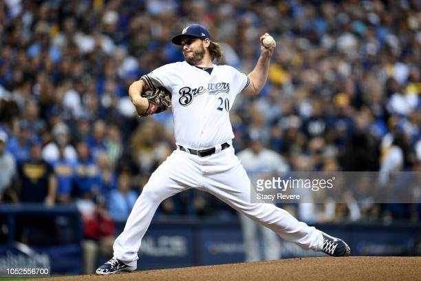 Wade Miley of the Milwaukee Brewers throws a pitch against the Los Angeles Dodgers during the first inning in Game Six of the National League...