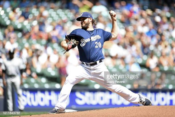 Wade Miley of the Milwaukee Brewers throws a pitch during the first inning of a game against the Colorado Rockies at Miller Park on August 5 2018 in...