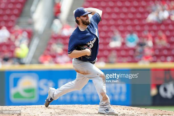 Wade Miley of the Milwaukee Brewers throws a pitch during the game against the Cincinnati Reds at Great American Ball Park on August 30 2018 in...