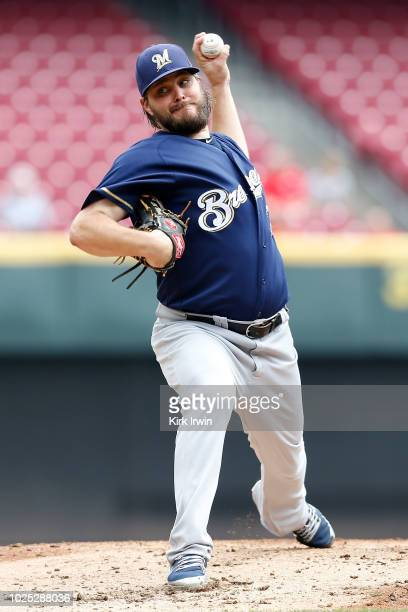 Wade Miley of the Milwaukee Brewers throws a pitch during the second inning of the game against the Cincinnati Reds at Great American Ball Park on...