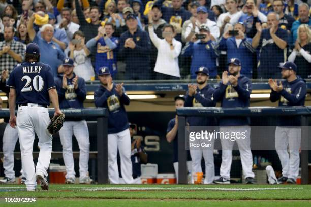 Wade Miley of the Milwaukee Brewers walks back to the dugout after being pulled during the sixth inning against the Los Angeles Dodgers in Game Two...