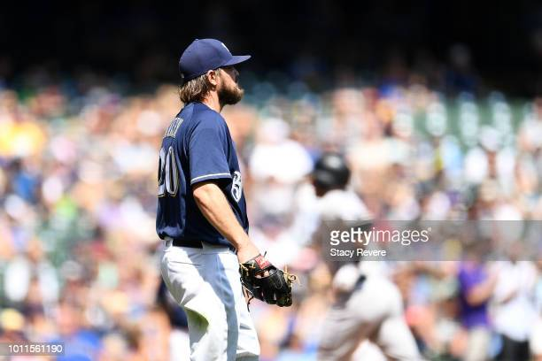 Wade Miley of the Milwaukee Brewers watches as Trevor Story of the Colorado Rockies runs the bases following a three run home run during the fifth...