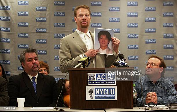 Wade Nichols holds up a picture of his partner Francis Shen of Taiwan during a news conference announcing that the ACLU is suing the state to allow...