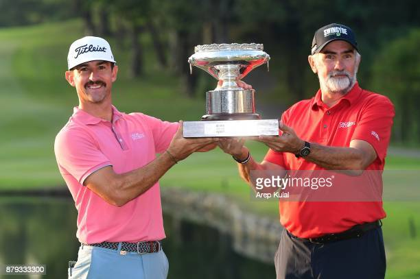 Wade Ormsby of Australia and his caddie pose with the trophy after winning the UBS Hong Kong Open at The Hong Kong Golf Club on November 26 2017 in...