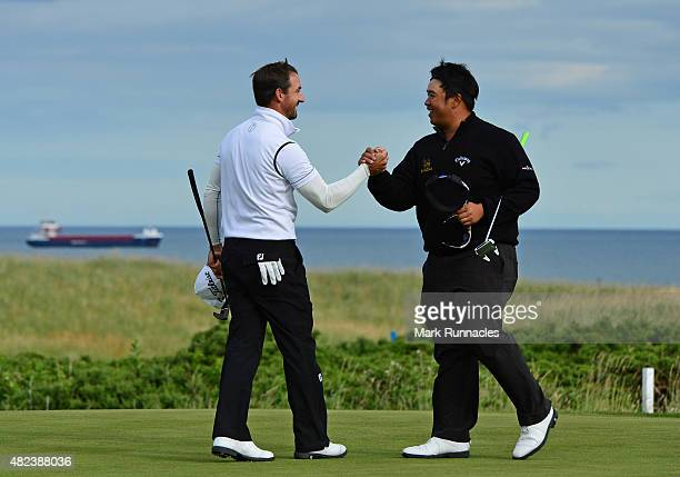 Wade Ormsby of Australia congratulates Kiradech Aphibarnrat of Thailand after he wins his match on the 19th hole during the first day of the Saltire...