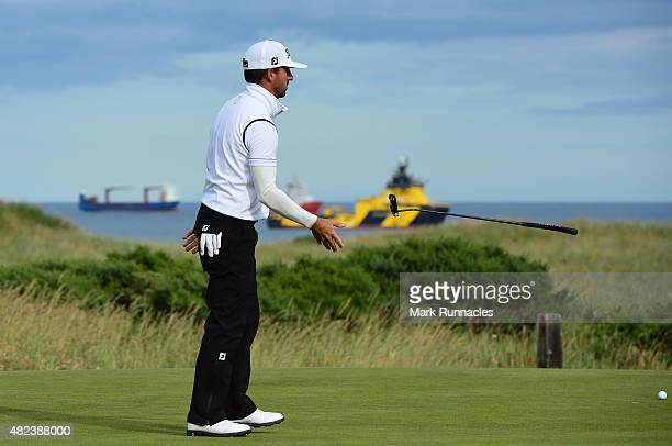 Wade Ormsby of Australia flips his putter after loosing out to Kiradech Aphibarnrat of Thailand at the 19th hole during the first day of the Saltire...