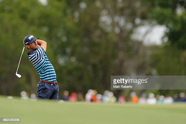Wade Ormsby of Australia hits his approach shot on the 7th hole during day four of the 2014 Australian PGA Championship at Royal Pines Resort on...