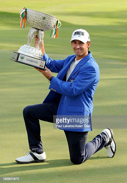 Wade Ormsby of Australia pictured with the winner's trophy after round four of the Panasonic Open India at Delhi Golf Club on April 7 2013 in New...