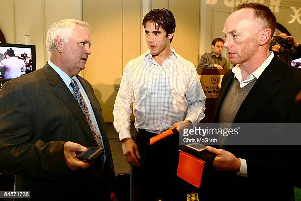 Wade Phillips, Brady Quinn, and Jeff Garcia test the ID Coach Wristband at the launch of the Isaac Daniel, ID Coach at the Sheraton Riverwalk on...