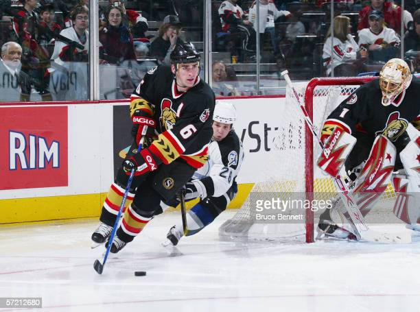 Wade Redden of the Ottawa Senators skates with the puck against the Tampa Bay Lightning at Scotiabank Place on March 14, 2006 in Ottawa, Ontario,...