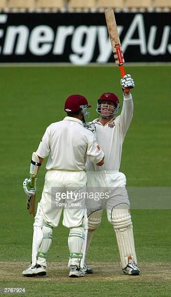 Wade Seccombe celebrates with Andy Bichel on reaching his century during the Pura Cup match between the Southern Redbacks and the Queensland Bulls at...