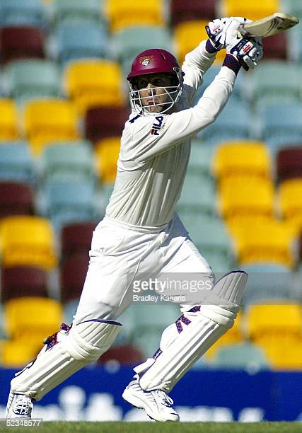 Wade Seccombe hits out during the Pura Cup match between the Queensland Bulls and Western Australia at Brisbane Cricket Ground on March 10 2005 in...