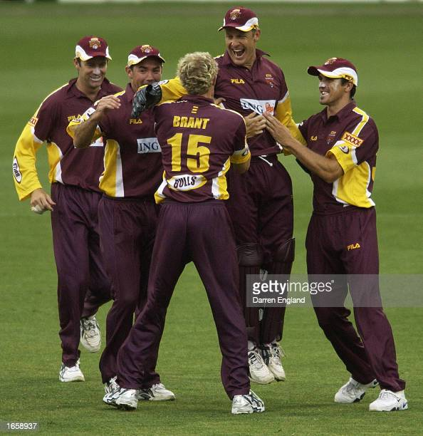 Wade Seccombe of Queensland celebrates with team mates after getting the catch off the wicket of Shane Watson of Tasmania for eight runs during the...