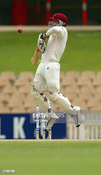 Wade Seccombe of the Bulls evades a rising ball from Paul Rofe in the Pura Cup match between the Southern Redbacks and the Queensland Bulls at...