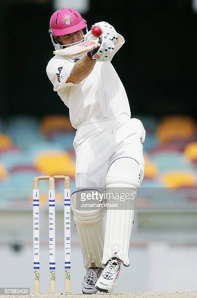 Wade Seccombe of the Bulls hits out during day four of the Pura Cup match between the Queensland Bulls and Western Warriors at the Gabba March 13...