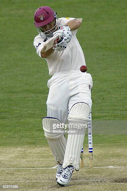 Wade Seccombe smashes the ball during the Pura Cup Cricket match between the Queensland Bulls and Western Australian Warriors March 11 2005 in...