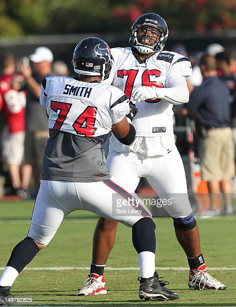 Wade Smith of the Houston Texans and Duane Brown of the Houston Texans hook up during training camp at Reliant Park on August 1 2012 in Houston Texas