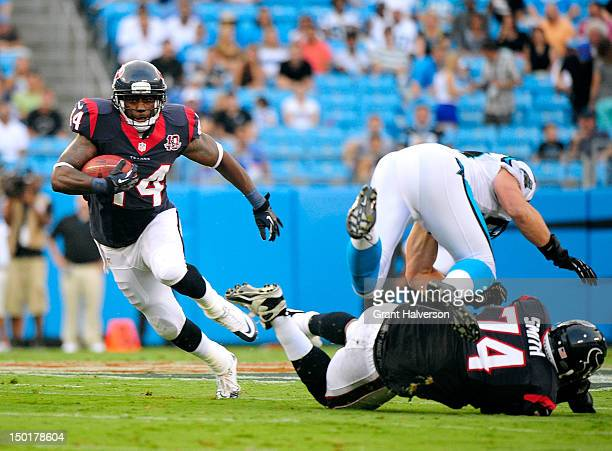 Wade Smith springs teammate Ben Tate of the Houston Texans for a first down during a preseason game against the Carolina Panthers at Bank of America...