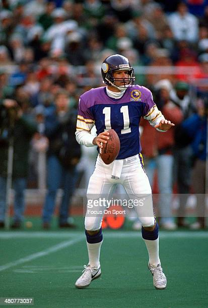 Wade Wilson of the Minnesota Vikings drops back to pass against the Philadelphia Eagles during an NFL Football game November 19 1989 at Veterans...