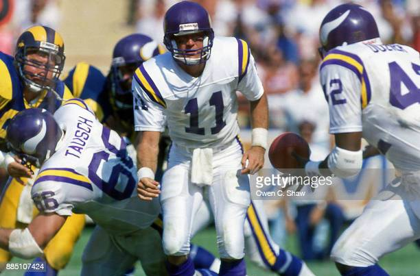Wade Wilson of the Minnesota Vikings pitches the ball to DJDozier against the Los Angeles Rams at Anaheim Stadium circa 1987 in AnaheimCalifornia on...