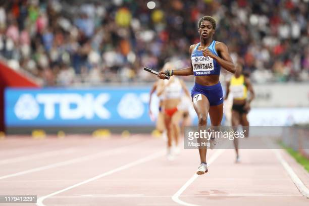 Wadeline Jonathas of the United States crosses the finish line to win gold for the United States in the Women's 4x400 metres relay final during day...