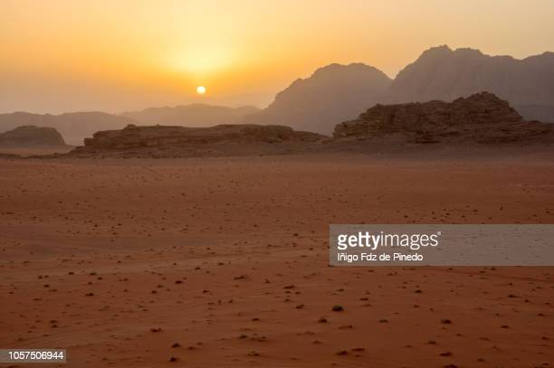 wadi rum at sunset, valley of moon, jordan. - mars stock pictures, royalty-free photos & images
