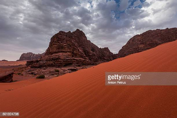 wadi rum desert landscape at sunruse, jordan - t.e. lawrence stock photos and pictures