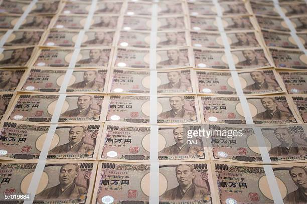 wads of money - japanese yen note stock photos and pictures