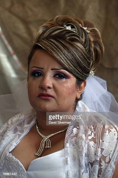 Waed Mundar a 25yearold Druze bride cries knowing she may never see her family again during wedding celebrations at her home September 19 2007 in her...