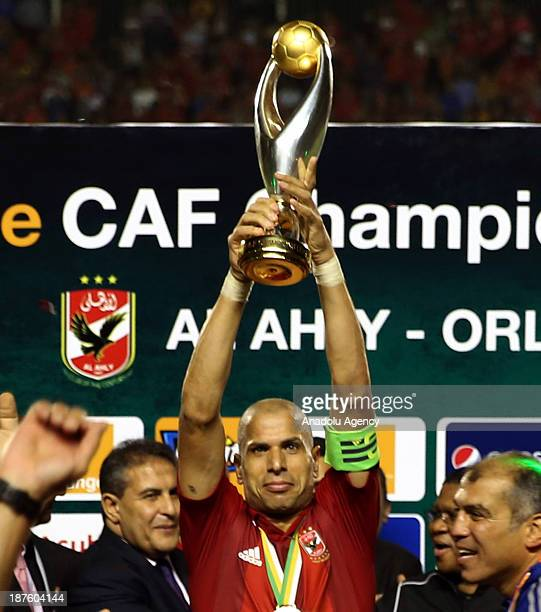 Wael Gomaa of Al Ahly lifts the trophy after the team's victory over Orlando Pirates in the CAF Champions League second leg final match between South...