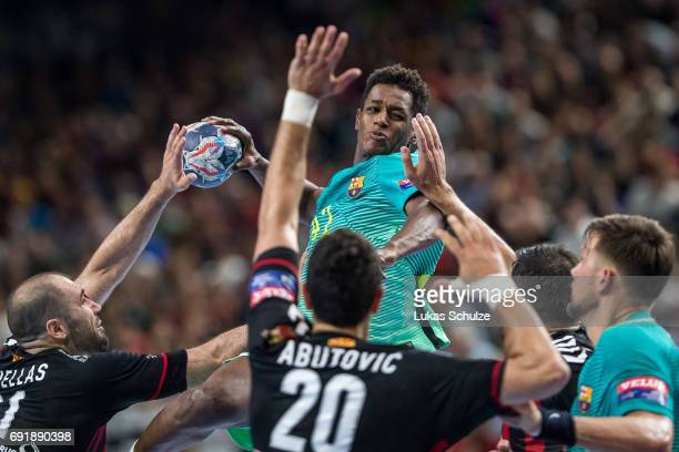 Wael Jallouz of Barcelona is attacked by the defense of Vardar during the VELUX EHF FINAL4 Semi Final match between HC Vardar and FC Barcelona Lassa...