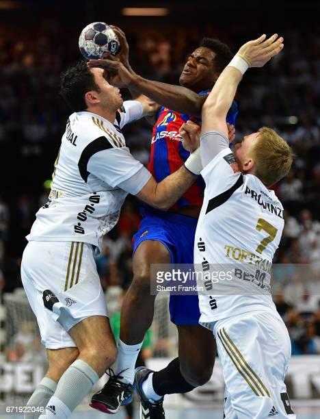 Wael Jallouz of Barcelona is challenged by Rene Toft Hansen and Blazenko Lackovic of Kiel during the EHF Champions League Quarter Final first leg...