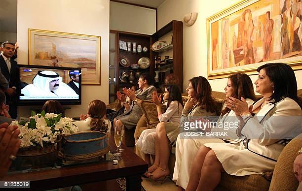 Wafaa Sleiman the wife of Lebanese presidentelect General Michel Sleiman applauds with family members as they watch Qatari Emir Sheikh Hamad bin...