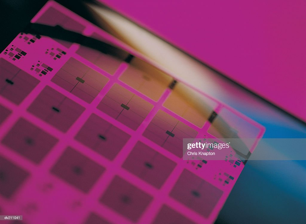 Wafer-chip abstraction overlaid with magenta etching : Stock Photo