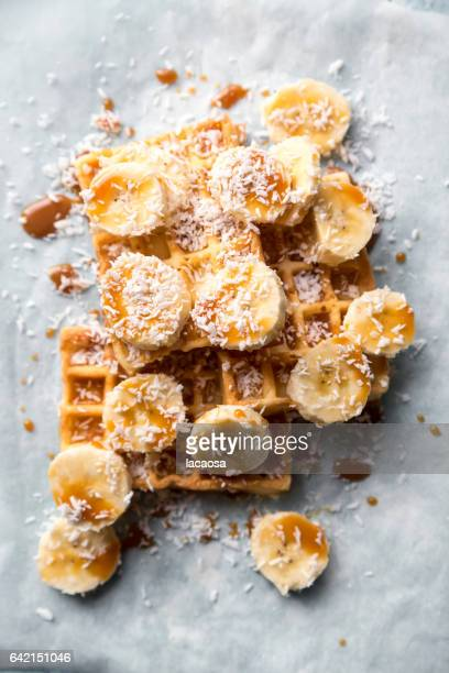 waffels with banana slices and caramel syrup