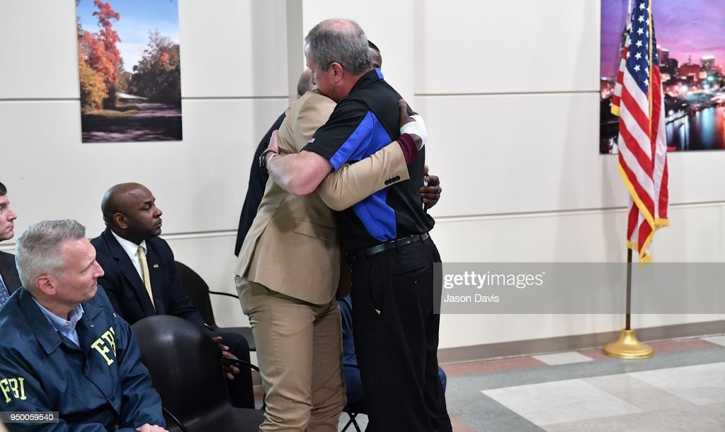 Waffle House President and CEO, Walt Ehmer embraces patron James Shaw, Jr. at a press conference discussing the shooting at a Waffle House where a gunman opened fire killing four and injuring two on April 22, 2018 in Nashville, Tennessee. Shaw, Jr., 29, took action disarming the gunman and ultimately forcing him out of the Waffle House restaurant. Travis Reinking, 29, of Morton, IL, is person of interest in the shooting and is suspected to have left the scene naked.