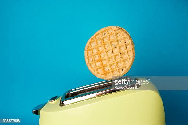 waffle popping out of toaster - waffle stock photos and pictures