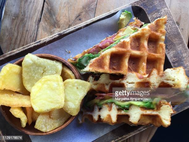 Waffle sandwich with avocado and bacon