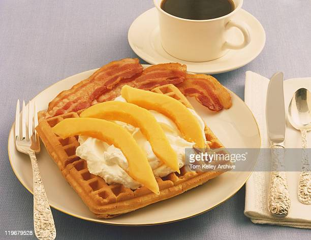 Waffle with cream and black tea, close-up