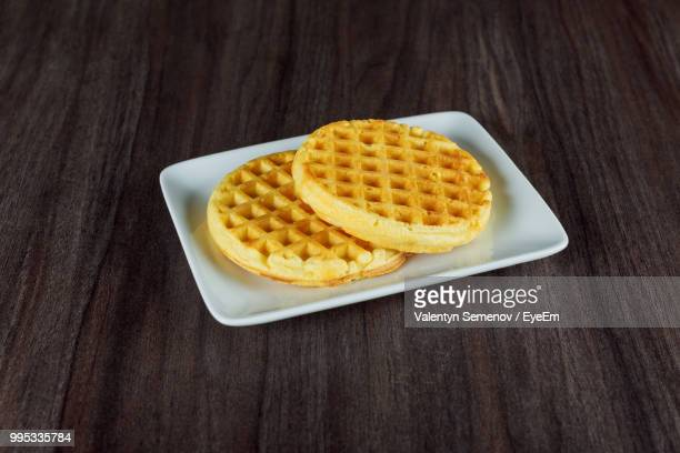 waffles in plate on table - waffle stock photos and pictures
