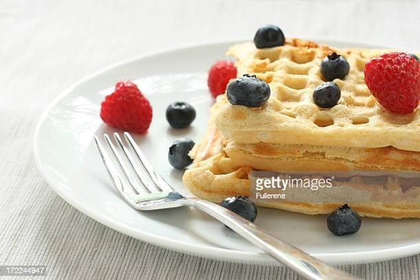 waffles with berries and fork