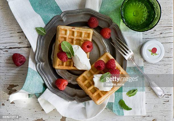 waffles with berries - anna verdina stock photos and pictures