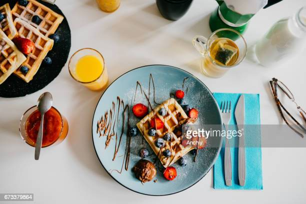 Waffles with blueberries, strawberries and and cholocate toping
