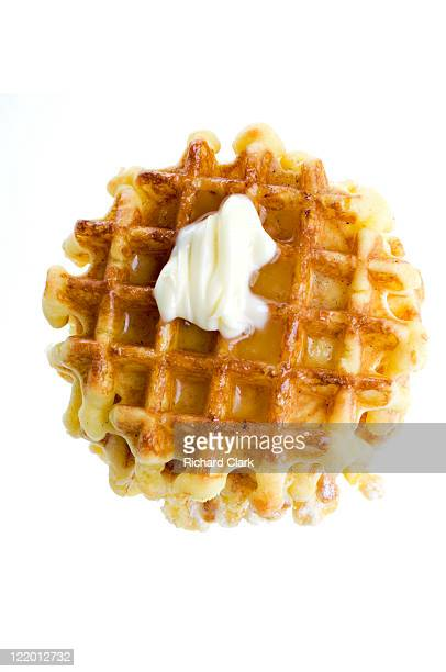 waffles with golden syrup and butter - waffle stock photos and pictures
