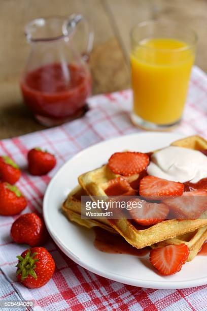 Waffles with strawberries and a strawberry sauce