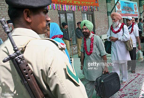 A Pakistani paramilitary soldier stands guard as Indian Sikh pilgrims arrive at the Wagah railway station 08 April 2007 Around 3000 Sikh pilgrims...