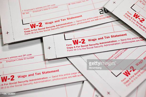 W2 wage and tax statement forms are arranged for a photograph in Washington DC US on Tuesday Nov 20 2012 President Barack Obama expressed confidence...