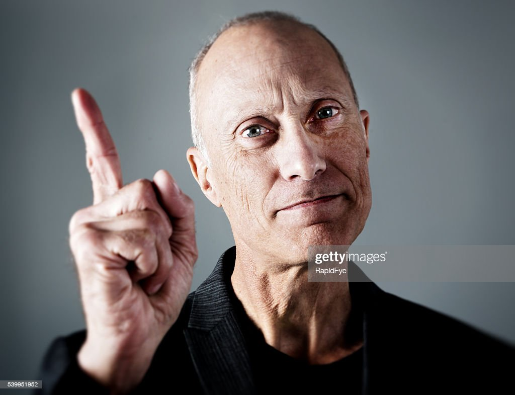 wagging finger, serious mature man, ticking off, remonstrating, boss, manager, : Stock Photo
